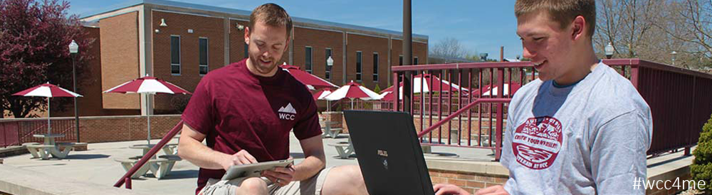 Student Outside using laptop and tablet computers