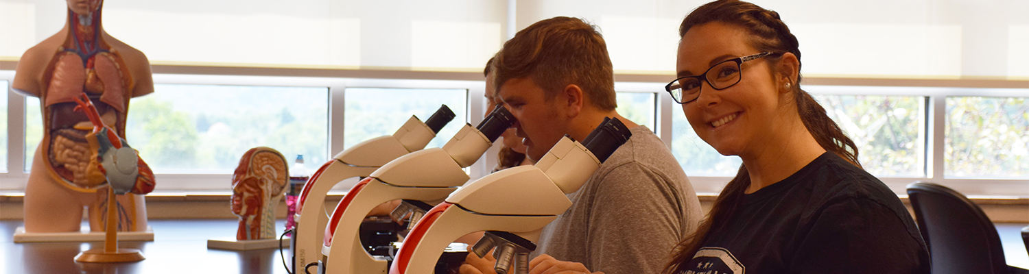 Students using microscopes in the Biology lab