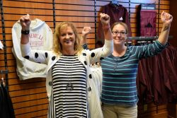Bookstore staff members, Marsha and Tabitha, celebrate meeting the challenge