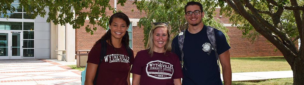 Three students standing outside of Smyth Hall on WCC campus