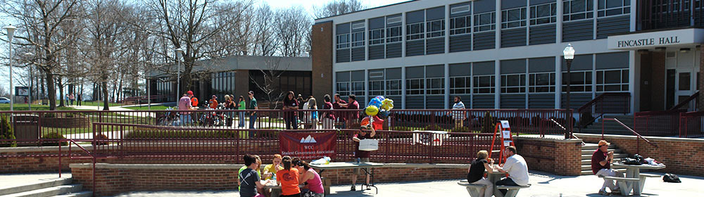 Students on the quad and in the patio seating area