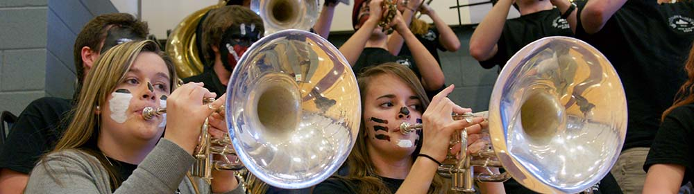 Students playing horns in the Pep Band